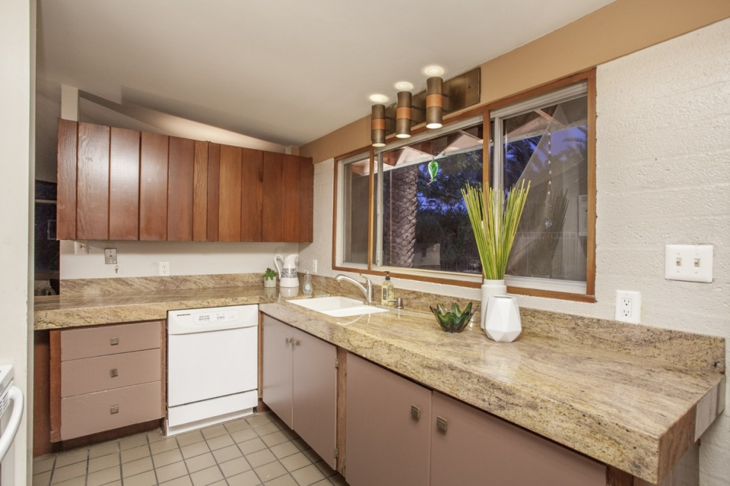 The original and intact cupboards are visible amongst the updates to this 1955 Al Beadle-designed property in Phoenix, AZ. Photo by Hi-Res Media.